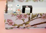 Place all your nail bottles in a box, pasting stickers on top to indicate the nail polish color. Easy, isn't it?