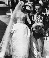 Grace Kelly wed Prince Rainier III of Monaco in a lace, silk taffeta, and tulle gown with a fitted bodice and flared skirt created by Helen Rose