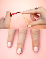 Tie a rubber band in the middle, and loop it between your thumb and finger to line the area for that perfect French manicure.